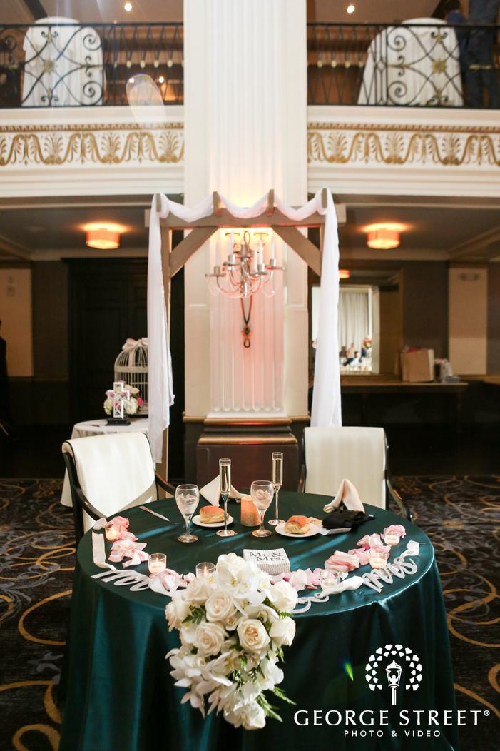 ballroom at the ben indoor wedding reception philadelphia wedding sweetheart table decor