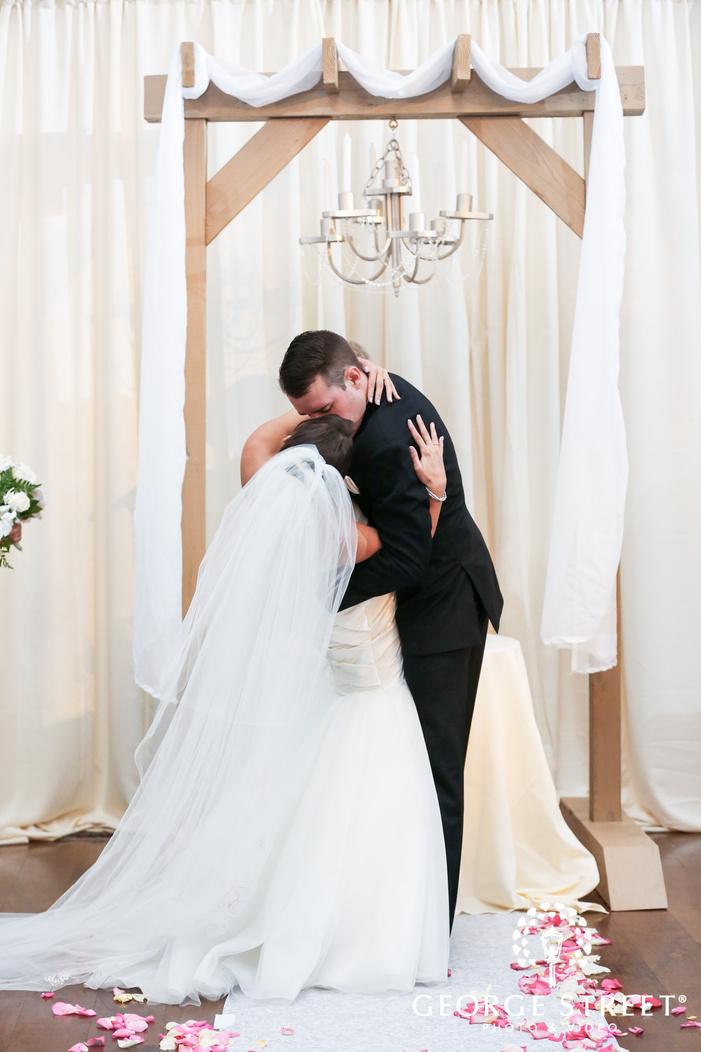 ballroom at the ben philadelphia indoor wedding ceremony first kiss candid