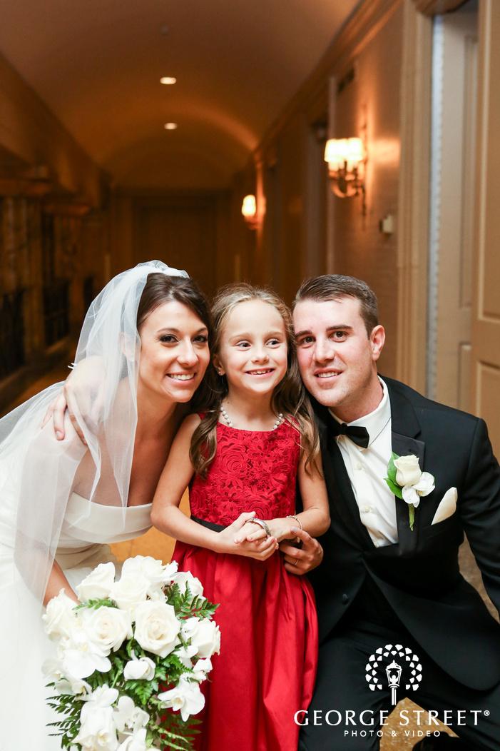 ballroom at the ben philadelphia indoor wedding reception bride and groom with flowergirl portrait