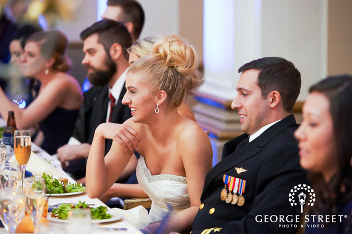 candid bride and groom at reception