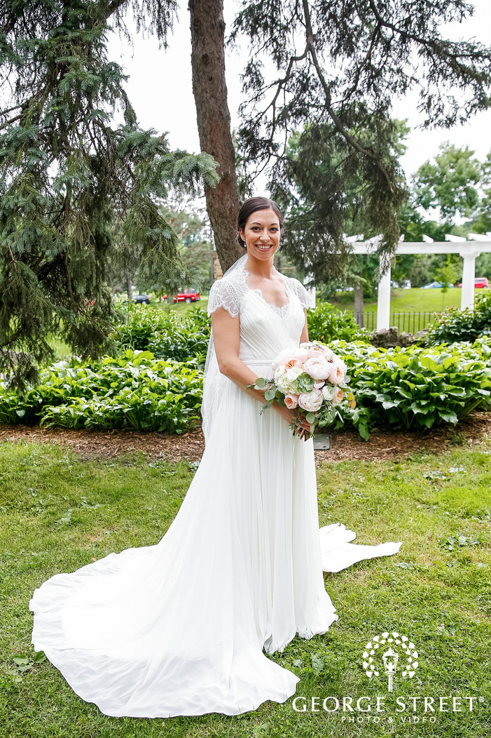 beautiful bride in green lawn wedding photography
