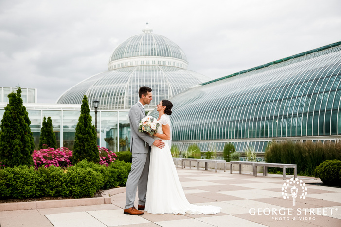 sweet bride and groom outside como park zoo and conservatory in minneapolis