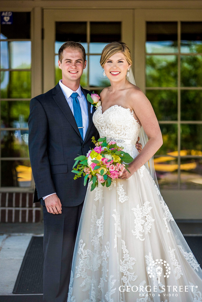 golden valley country club lovely couple on mansion entrance minneapolis wedding photos
