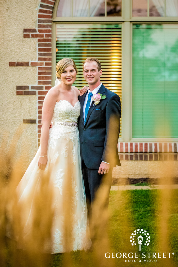 golden valley country club loving bride and groom in yard minneapolis wedding photos