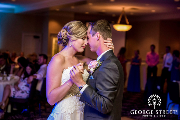 lovely bride and groom first dance on reception dance floor golden valley country club minneapolis wedding photos