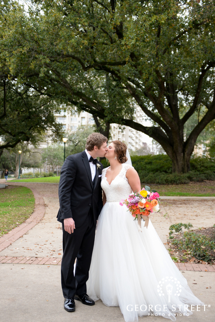bride and groom kissing airy outdoor portrait