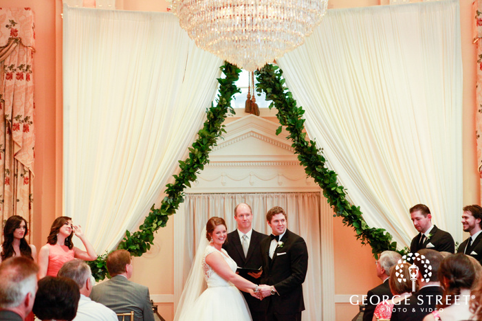 bride and groom under canopy