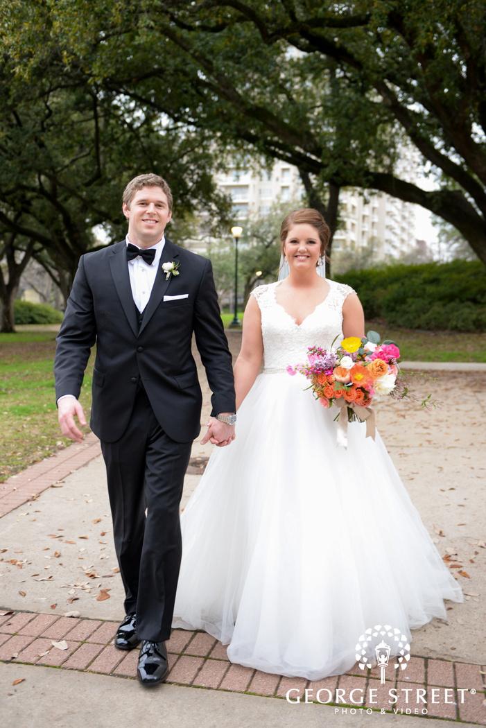 bride and groom walking down path