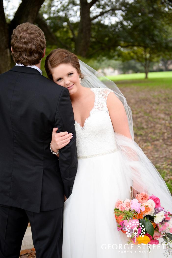 bride leaning on grooms shoulder adorable outdoor portrait