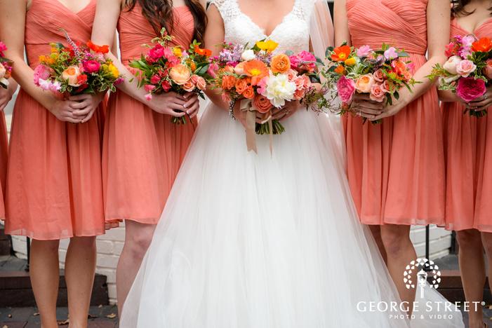 bridesmaids with bouquets detail portrait