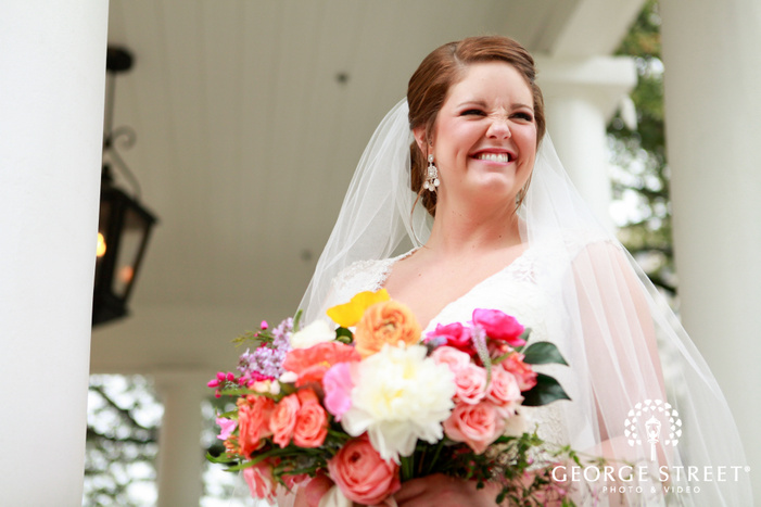 candid bride with bouquet airy outdoor portrait
