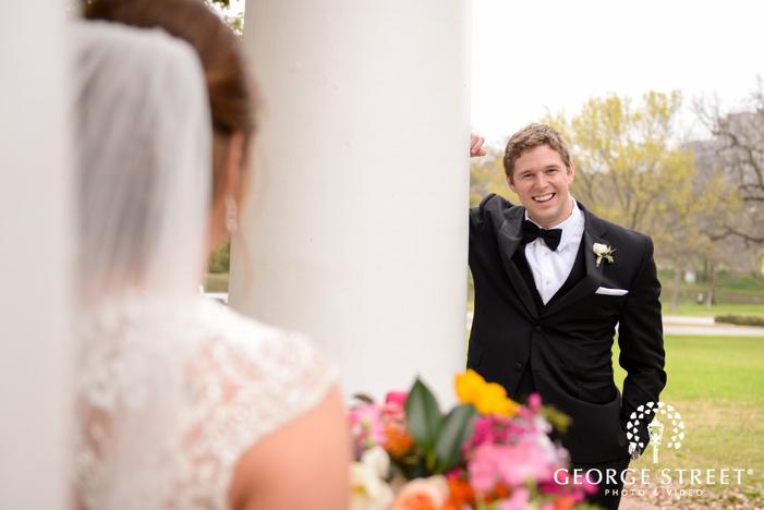 happy groom looking at bride