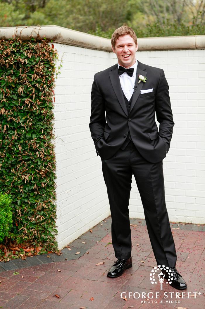 laughing groom outdoor wedding portrait