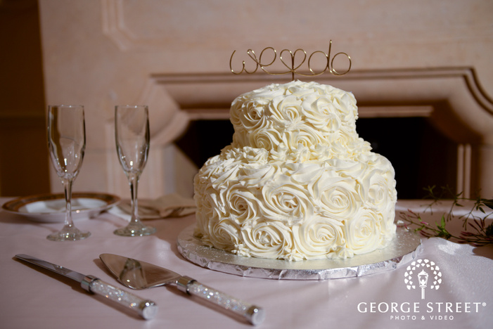 simple wedding cake with we do cake topper