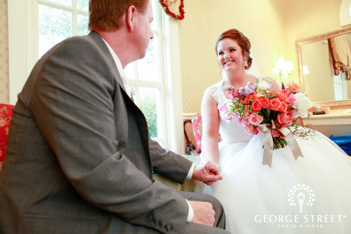 smiling bride holding fathers hand
