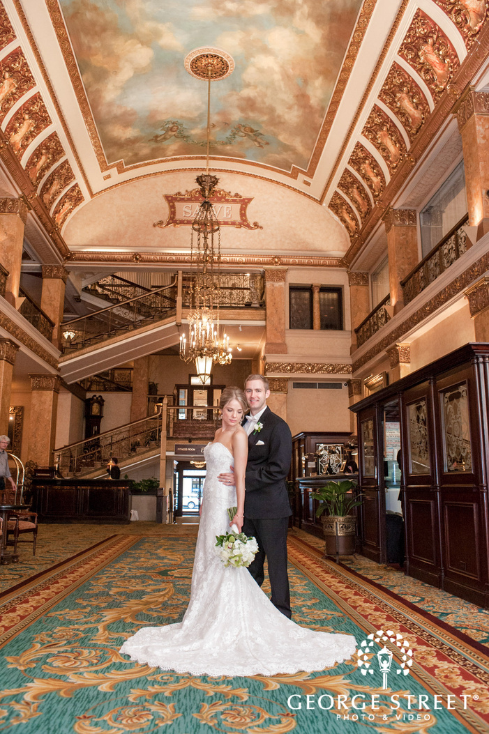 adorable bride and groom in hotel lobby at the pfister hotel in milwaukee