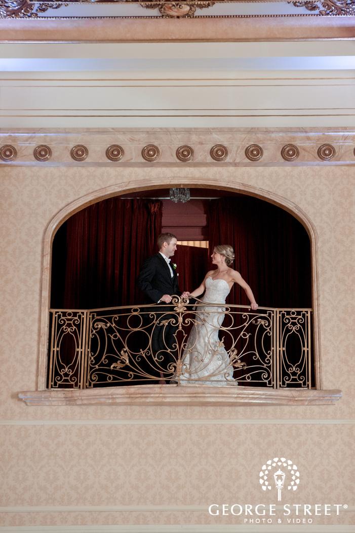 gorgeous couple at hotel balcony wedding photography