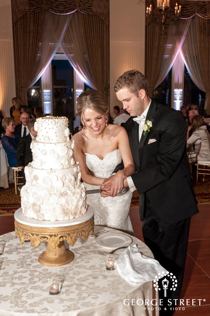 happy bride and groom cake cutting wedding photo