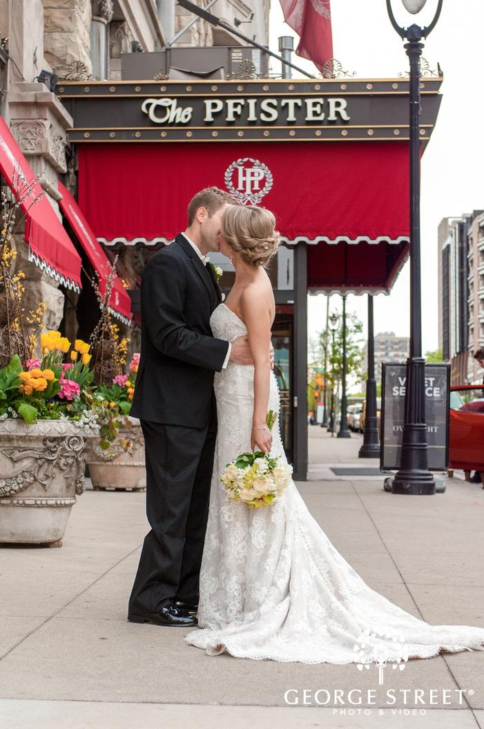 romantic bride and groom on a street near hotel entrance wedding photography