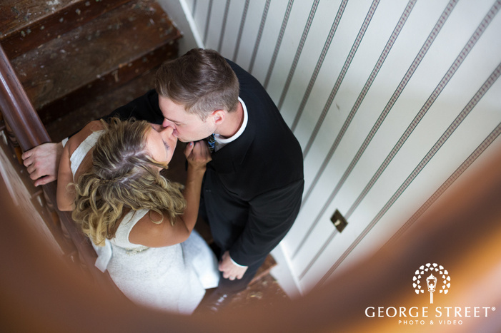 Bride and Groom Kissing in Stairwell