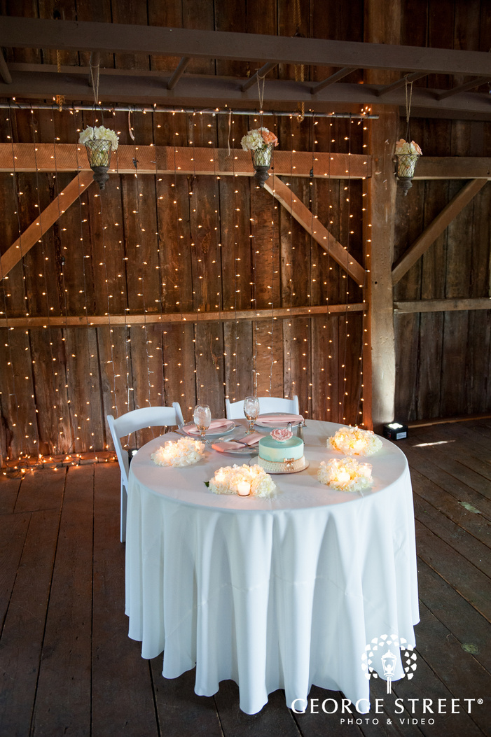 Bride and Groom Sweetheart Table with Hanging Lights