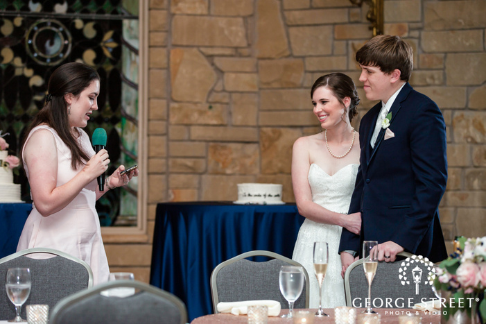 beautiful bride and groom during reception toast