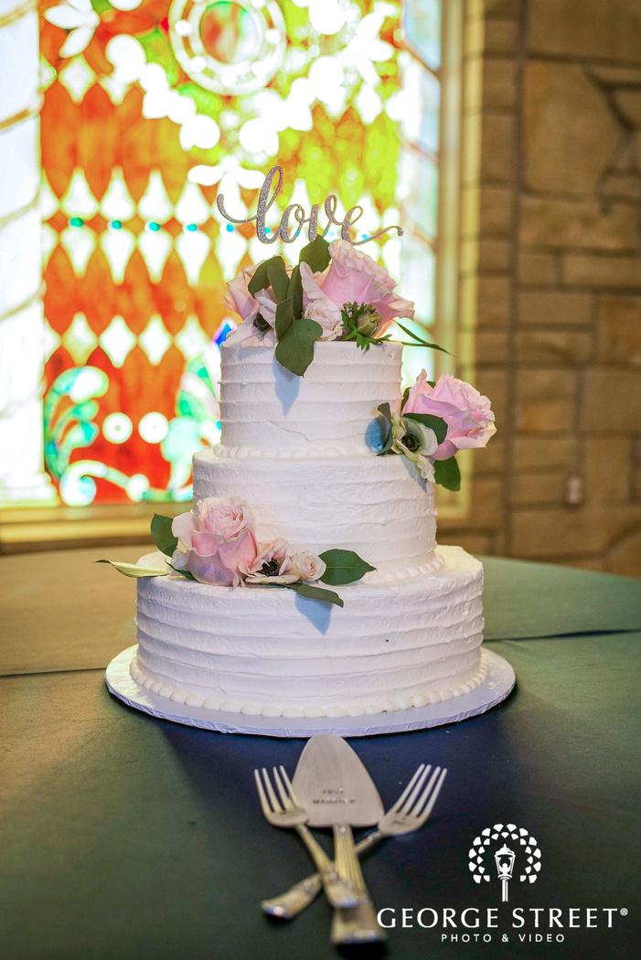 delicious three tier rose topper wedding cake