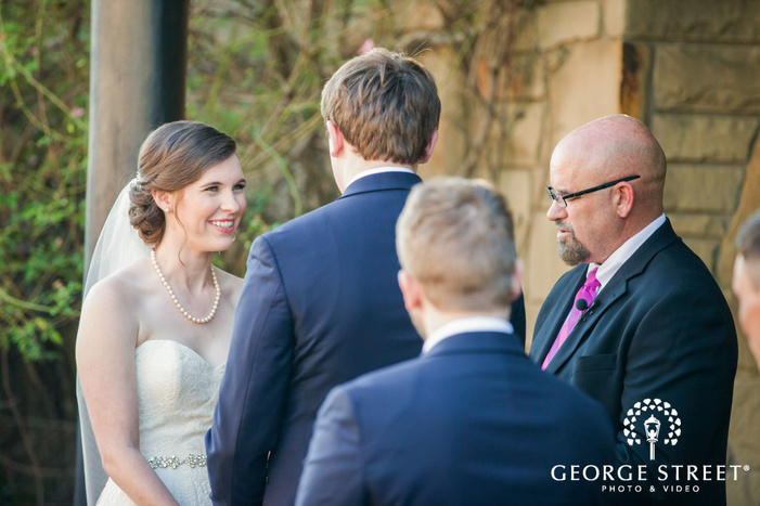 excited bride and groom at wedding ceremony