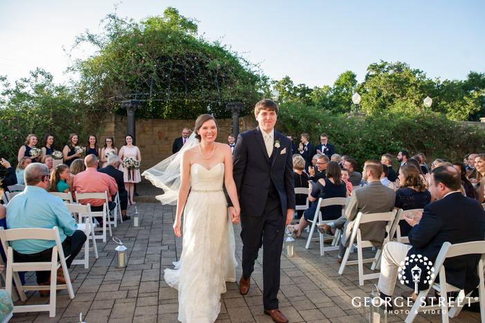 joyful bride and groom at ceremony exit