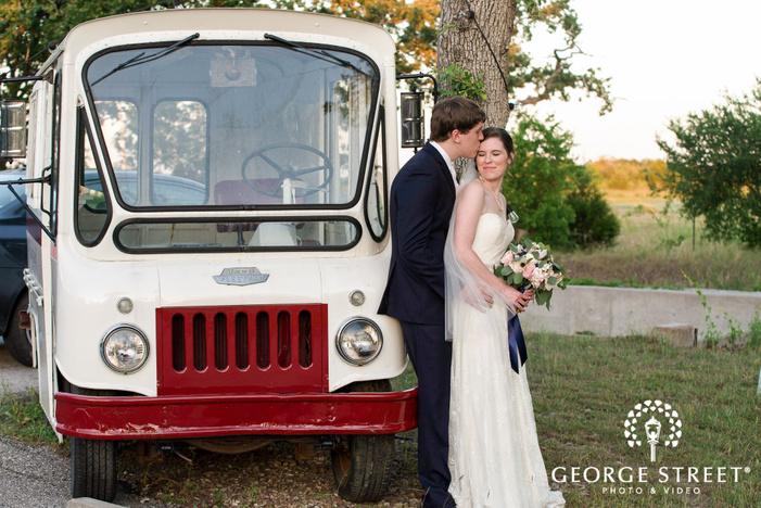 ravishing bride and groom infront of van