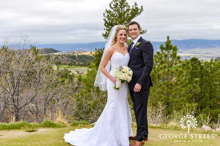 blissful bride and groom at hill top in denver wedding photography