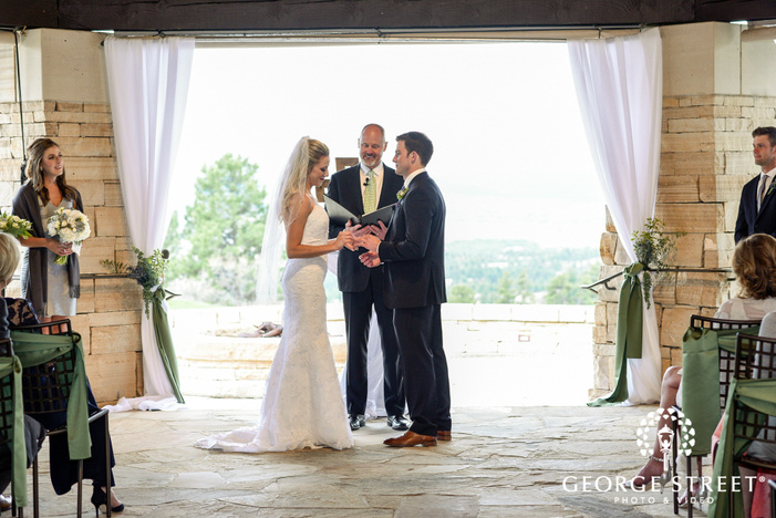 blissful bride and groom ring exchange ceremony wedding photo