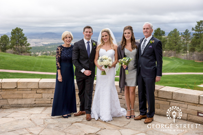 blissful couple and parents at sanctuary golf course patio wedding photo