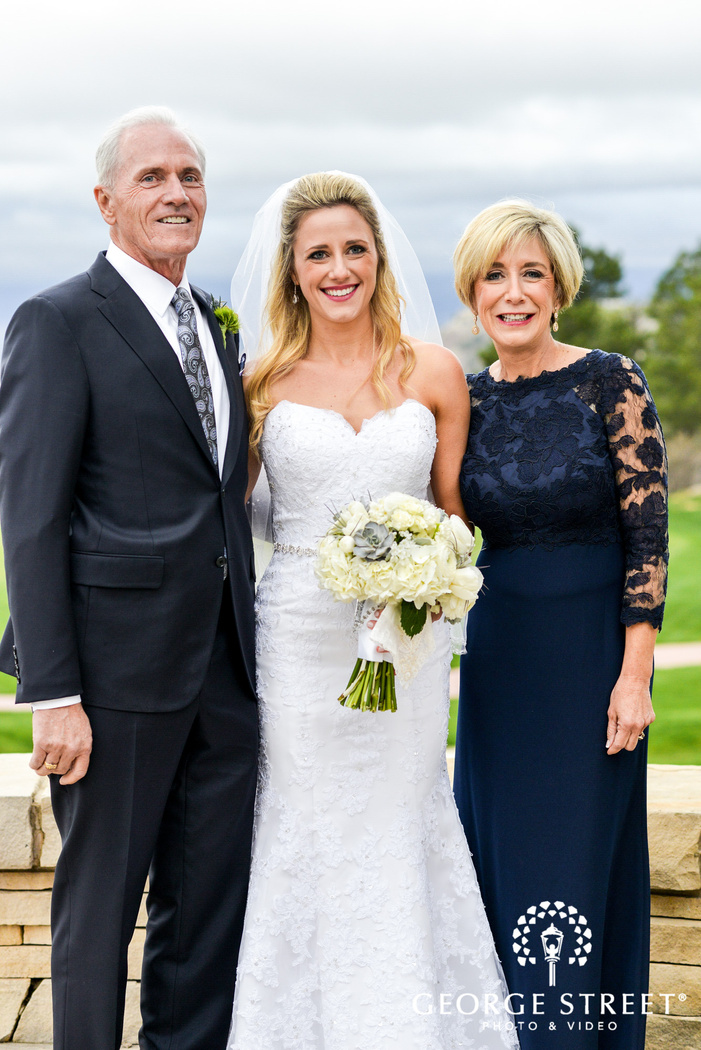 cute bride and parents at patio wedding photography