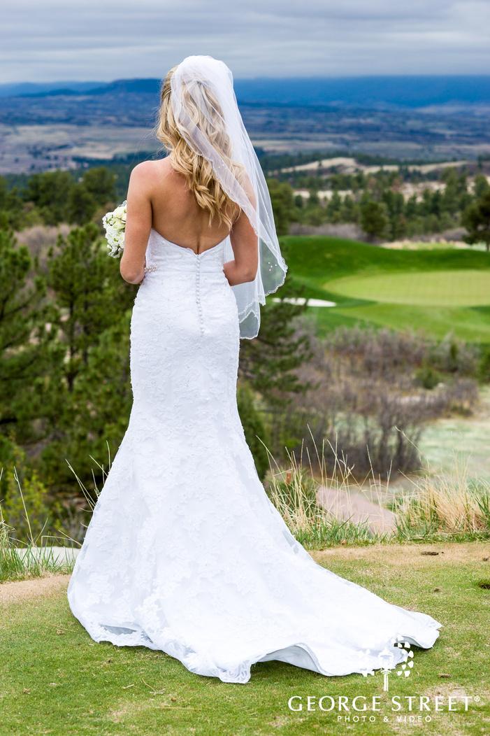 cute bride in grassland wedding photo