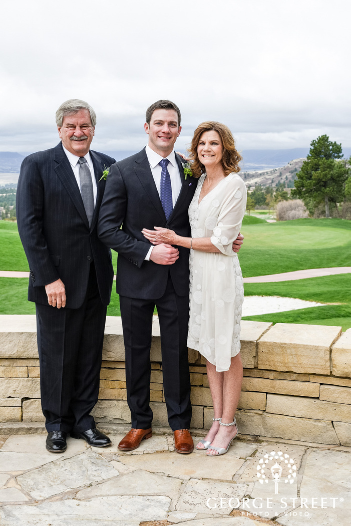 handsome groom and parents at patio wedding photo