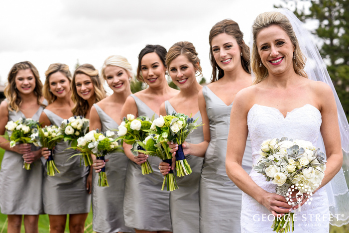 joyful bride and group at green hilltop wedding photography