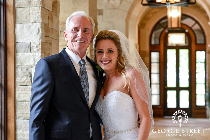 loving bride and father in hallway at sanctuary golf course in denver wedding photo
