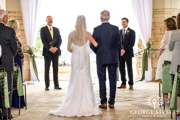 loving bride and father walking down the aisle wedding photo