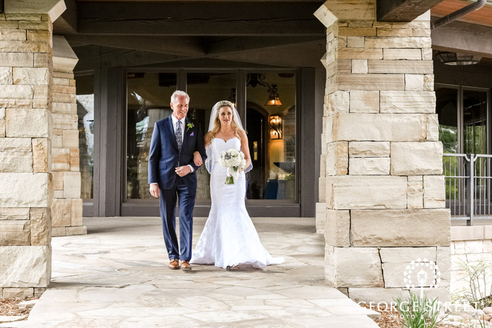 loving bride and father walking towards wedding altar at sanctuary golf course wedding photo