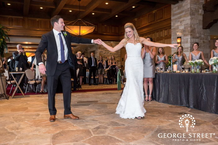 loving bride and groom first dance in reception hall at sanctuary golf course wedding photos