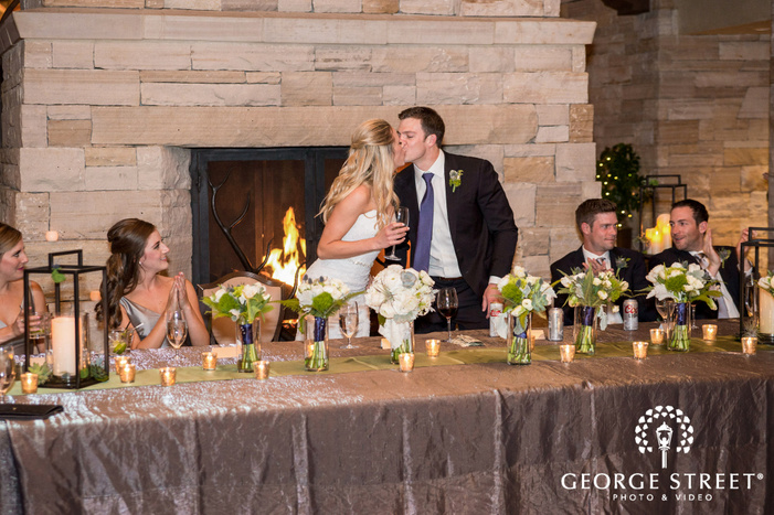 romantic bride and groom at reception table wedding photo