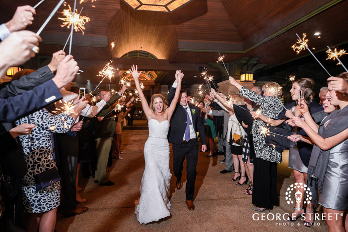 romantic couple exit from reception at sanctuary golf course in denver wedding photos