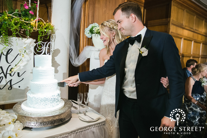 charming bride and groom cake cutting ceremony wedding photo