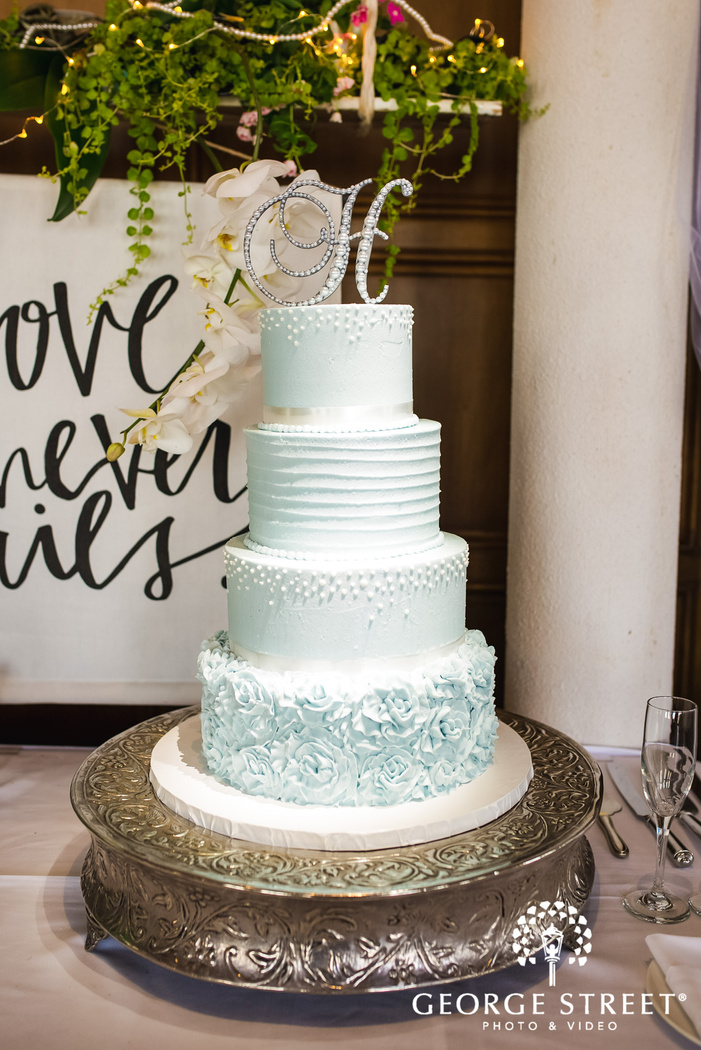 lovely four tier cake with topper wedding photography