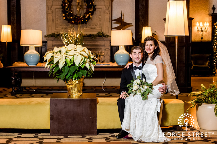 adorable bride and groom in lobby at alden castle in boston