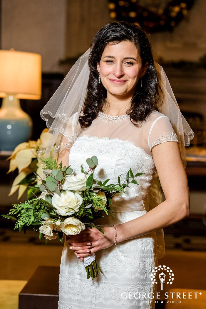 beautiful bride posing in foyer wedding photography