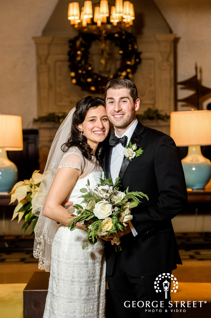charming bride and groom in foyer wedding photography
