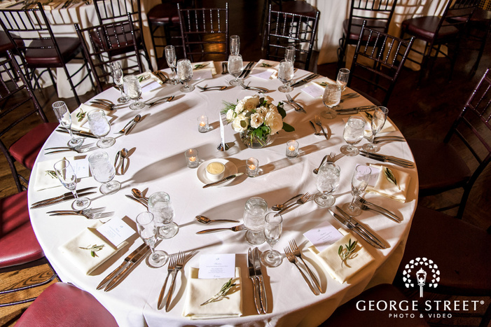 classy reception hall table setting details wedding photo