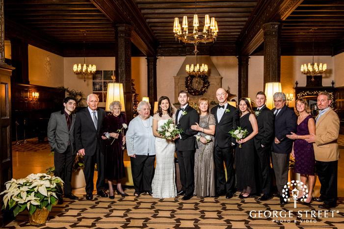 happy couple and family in hallway wedding photography